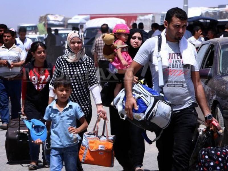33 de migranţi din Irak, dintre care 11 copii, au fost descoperiţi ascunşi într-un TIR, în Arad