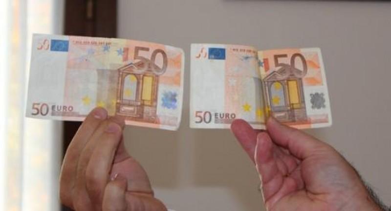 Arest la domiciliu pentru tânărul ce şi-a cumpărat telefoane mobile cu euro falşi