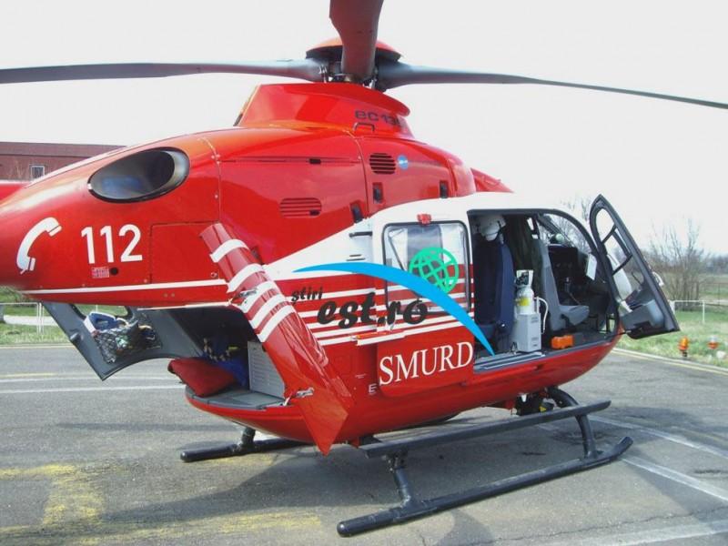 Femeie preluată în stare critică de un elicopter SMURD, după ce a căzut din căruță
