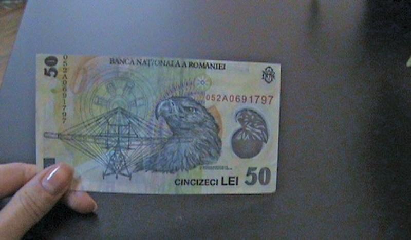 O tânără din Botoșani a încercat să schimbe o bancnotă falsă!
