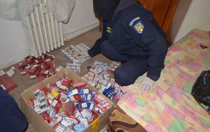 Percheziții imobiliare: Sute de pachete de țigări găsite în locuința unei femei de 62 de ani, din Corni!