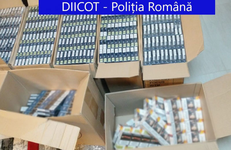 Percheziții și opt arestări într-un dosar de contrabandă cu țigări. Grupare condusă din închisoare, destructurată de DIICOT