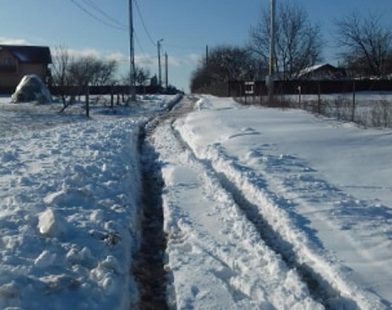 Poza zilei: iarna pe uliță, cu taxe de oraș