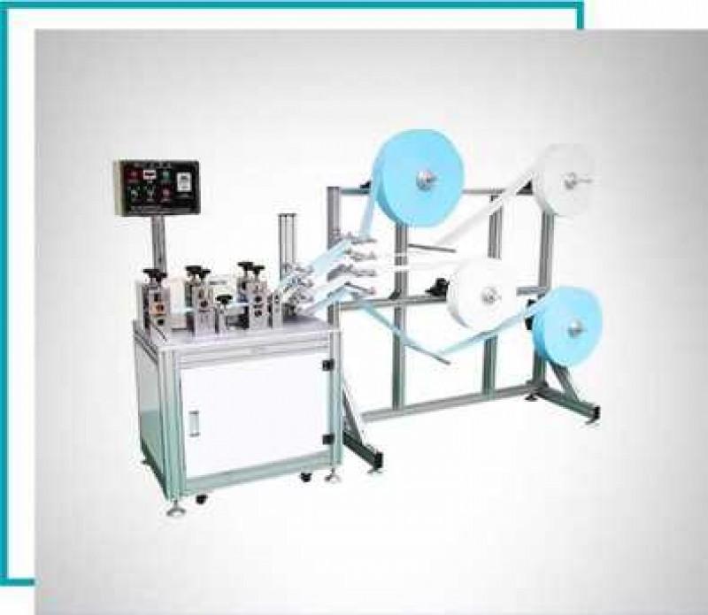 Mașină de confecționare a măștilor de față și fabricare de mănuși